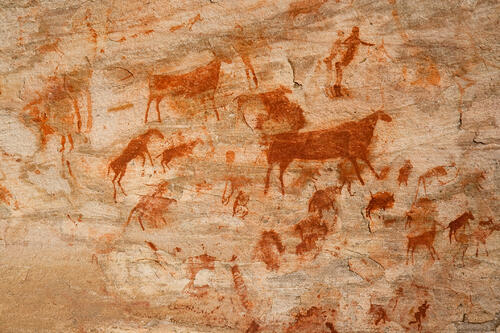 cave paintings on a rock communication