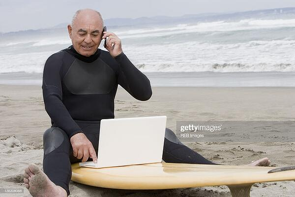 man with a laptop on the beach